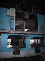 二階建て製麹機、上から原料麦を投入して二階で洗麦・製麹、一階の三角棚ではぜ混む(柳田酒造合名会社)